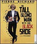 TALL BLOND MAN WITH ONE BLACK SHOE